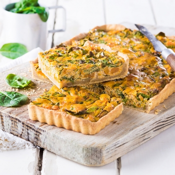 Pumpkin and curd cheese pie with spinach and walnuts